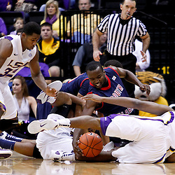 November 23, 2011; Baton Rouge, LA; LSU Tigers forward Storm Warren (24) and South Alabama Jaguars guard Xavier Roberson (3) battle for a loose ball during the first half of a game at the Pete Maravich Assembly Center.  Mandatory Credit: Derick E. Hingle-US PRESSWIRE