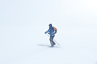 Man skiing in wind and fog