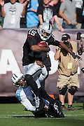 Oakland Raiders wide receiver Michael Crabtree (15) carries the ball against the Tennessee Titans at Oakland Coliseum in Oakland, Calif., on August 26, 2016. (Stan Olszewski/Special to S.F. Examiner)