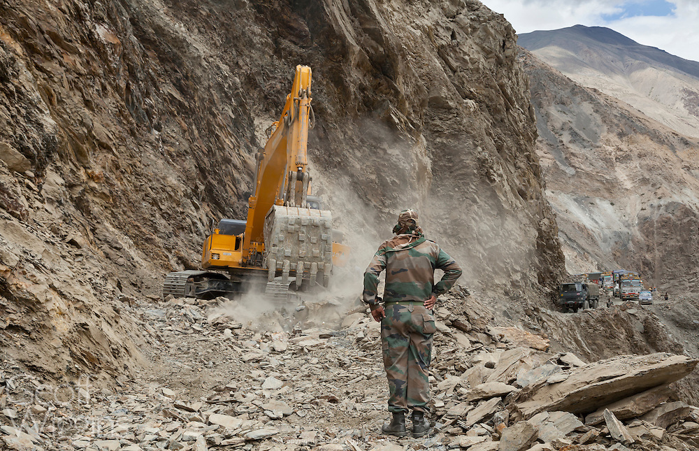 Excavator from the Indian, Border Roads Organization clear hazardous Himalayan mountain road following landslide, Pooh, Himachal Pradesh, India
