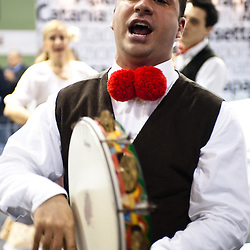 Milan, Italy - February  17: A performer sings  dressing in a traditional sicilian outfit at BIT International Tourism Exchange on february 17, 2012 in Milan, Italy.