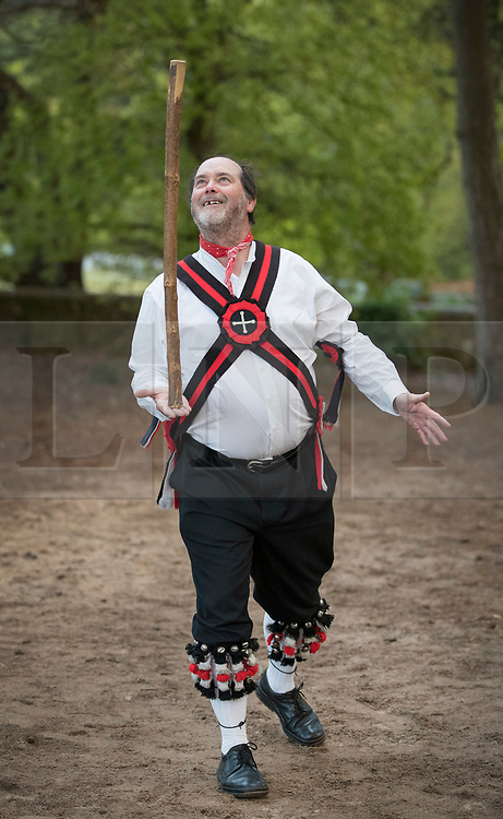 © Licensed to London News Pictures. 01/05/2017. Albury, UK. One of The Pilgrim Morris Men of Guildford balances his stick in between dances performed at dawn on May Day on St Martha's Hill. Photo credit: Peter Macdiarmid/LNP