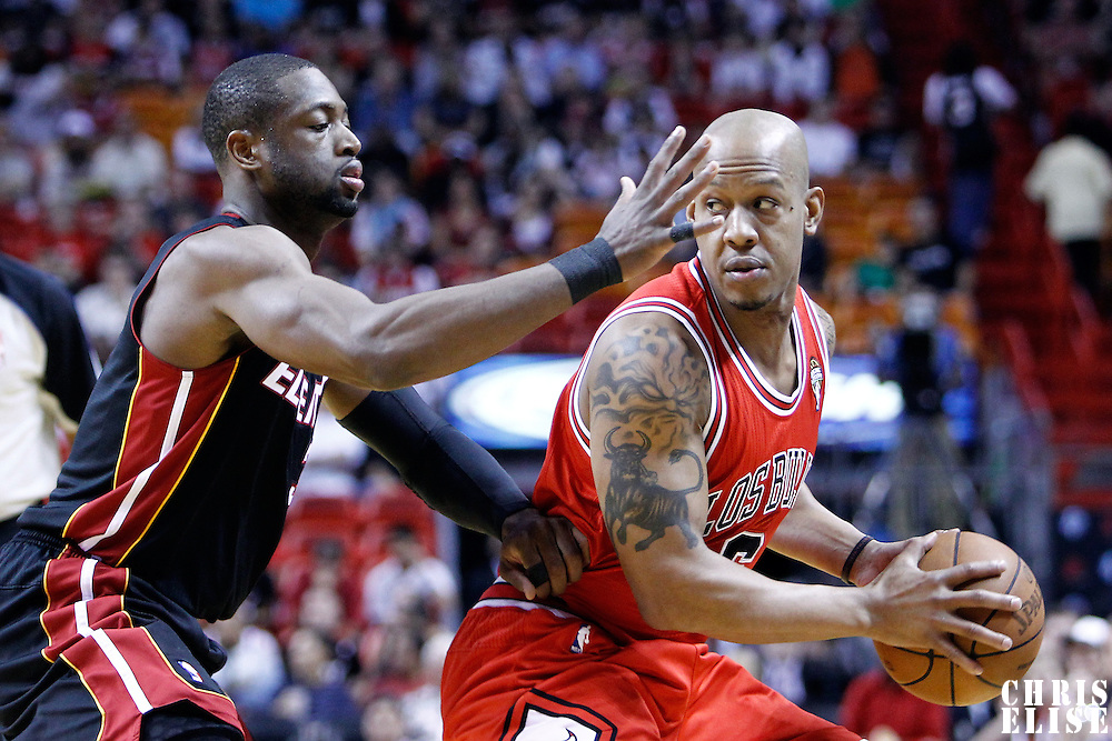 06 March 2010: Miami Heat shooting guard Dwyane Wade (3) defends on Chicago Bulls shooting guard Keith Bogans (6) during the Chicago Bulls 87-86 victory over the Miami Heat at the AmericanAirlines Arena, Miami, Florida, USA.