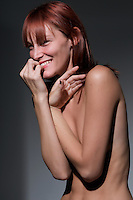 Sensual red hair young caucasian woaman laughing and smiling.