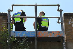 © Licensed to London News Pictures. 18/06/2018. London, UK. Emergency services attend Loughborough Junction station after it was reported that three people have been killed after being hit by a train. Photo credit: Rob Pinney/LNP