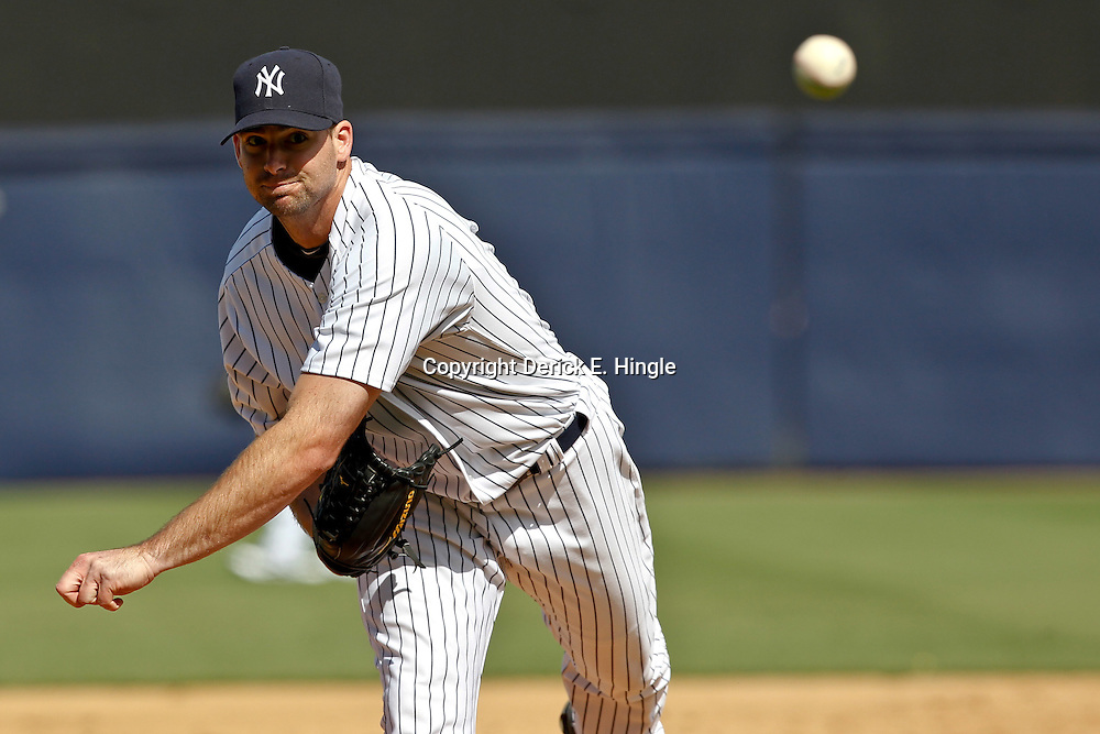 March 4, 2012; Tampa Bay, FL, USA; New York Yankees relief pitcher Boone Logan (48) during spring training game against the Philadelphia Phillies at George M. Steinbrenner Field. Mandatory Credit: Derick E. Hingle-US PRESSWIRE