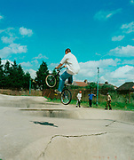 Teenager doing a trick in the air on his BMX motion
