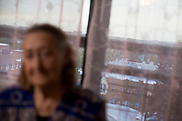 """27 October, 2008. New York. The view of Bensonhurst, Brooklyn, from Faina Ryzhikova's apartment. Faina El'man Ryzhikova, 82, a Jewish holocaust survivor and guerilla fighter, is here in her apartment in Bensonhurst, Brooklyn, NY. After asking for help, the Edith and Carl Marks Jewish Community House of Bensonhurst assisted her by tapping The New York Times Needieset funds for utility expenses of $50/month for 6 months, the first grant starting on October 3, 2008.<br /> <br /> Faina Ryzhikova was born in 1926 in Radoshkovichi, a little village 22 miles northwest from Minsk, Belarus. Back in 1939, this territory belonged to Poland. When the Germans occupied Radoshkovichi, in 1941, they created a ghetto, where Faina and her family lived and worked. In order to escape a planned pogrom by the Germans in 1942, Faina escaped into the forest where she later met the partisans of the brigade """"Narodnie Mstiteli"""" (Avengers of the people), which she joined.<br /> <br /> Faina's mother and sisters were killed while trying to escape. Her father survived and joined aina in 1943. Of the 2000 people that lived in the Radoshkovichi ghetto, only 18 survived. She married Vladimir Ryzhikov in 1954 and raised two sons. Faina's husband passed away in 1991, before the family came to the United States.<br /> <br /> <br /> ©2008 Gianni Cipriano for The New York Times<br /> cell. +1 646 465 2168 (USA)<br /> cell. +1 328 567 7923 (Italy)<br /> gianni@giannicipriano.com<br /> www.giannicipriano.com"""