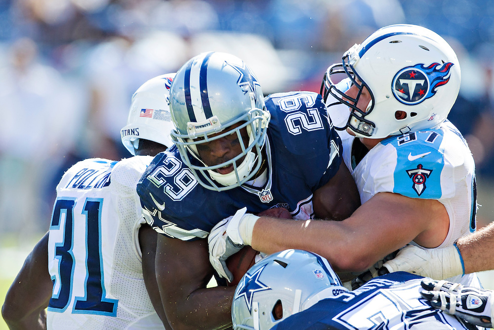 NASHVILLE, TN - SEPTEMBER 14:  DeMarco Murray #29 of the Dallas Cowboys is tackled by Bernard Pollard #31 and Karl Klug #97 of the Tennessee Titans at LP Field on September 14, 2014 in Nashville, Tennessee.  The Cowboys defeated the Titans 26-10.  (Photo by Wesley Hitt/Getty Images) *** Local Caption *** DeMarco Murray; Bernard Pollard; Karl Klug