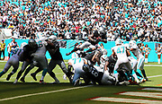 Sep 23, 2018; Miami Gardens, FL, USA; Oakland Raiders running back Marshawn Lynch (24) leaps over the pile to score a touchdown in the 3rd quarter putting the Raiders up 17-7 at Hard Rock Stadium between the Miami Dolphins and the Oakland Raiders. The Dolphins however defeated the Raiders 28-20. (Steve Jacobson/Image of Sport)