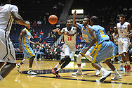 "Ole Miss guard Jarvis Summers (32) vs. southern University Jaguars center Frank Snow (22) at the C.M. ""Tad"" Smith Coliseum in Oxford, Miss. on Thursday, November 20, 2014. (AP Photo/Oxford Eagle, Bruce Newman)"