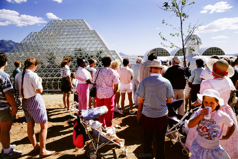 USA_SCI_BIOSPH_80_xs <br /> Biosphere 2 Project undertaken by Space Biosphere Ventures, a private ecological research firm funded by Edward P. Bass of Texas.  A group of tourists visiting Biosphere 2.  Biosphere 2 was a privately funded experiment, designed to investigate the way in which humans interact with a small self-sufficient ecological environment, and to look at possibilities for future planetary colonization. The $30 million Biosphere covers 2.5 acres near Tucson, Arizona, and was entirely self- contained. The eight 'Biospherian's' shared their air- and water-tight world with 3,800 species of plant and animal life. The project had problems with oxygen levels and food supply, and has been criticized over its scientific validity. 1991