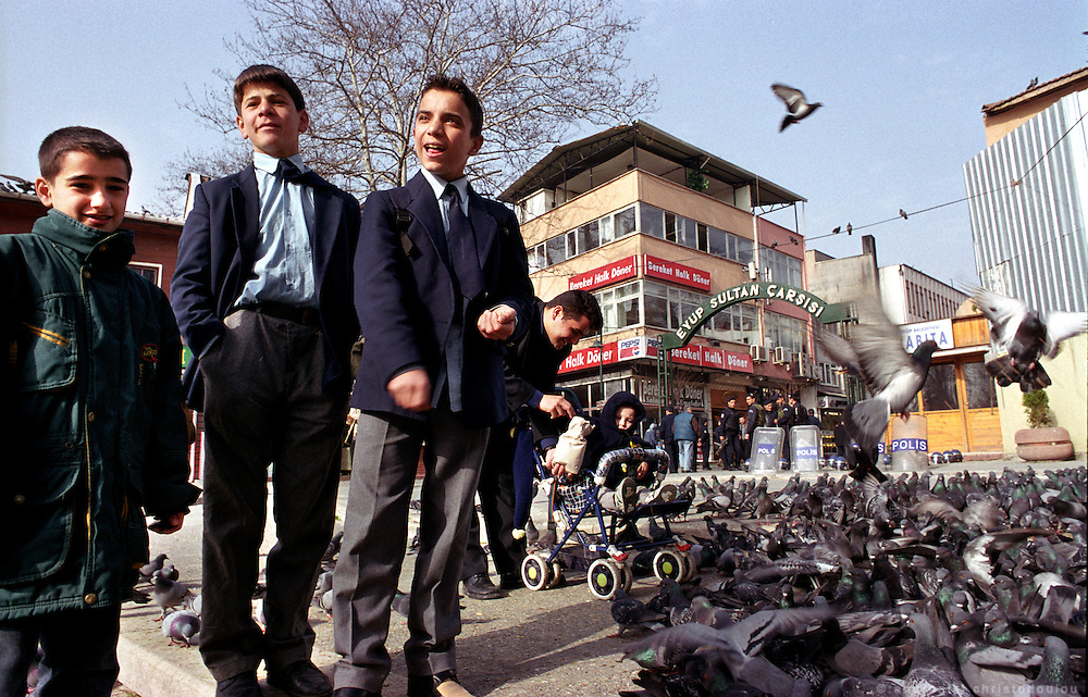 Schoolboys in Eyup. In the background Turkish riot police is ready to stop Schoolgirls who refuse to go to school without wearing the Islamic scarf from entering their school, and to confront Islamists who are expected to demonstrate in support of them. .ISTANBUL, Androniki Christodoulou/WorldPictureNews