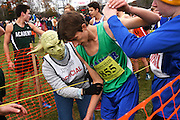 Dressed as Yoda to celebrate Halloween and cheer runners as they cross the finish at the Vermont Principals Association Cross Country Championship at Thetford Academy, Marty Jacobs, of Thetford, lends a hand to Ethan Dean, of Colchester, Saturday, October 31, 2015. (Valley News - James M. Patterson)<br /> Copyright &copy; Valley News. May not be reprinted or used online without permission. Send requests to permission@vnews.com.