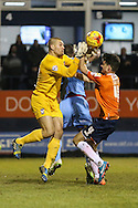 Jonathan Smith of Luton Town (right) challenges Robert Olejnik of York City for the ball during the Sky Bet League 2 match at Kenilworth Road, Luton<br /> Picture by David Horn/Focus Images Ltd +44 7545 970036<br /> 10/02/2015