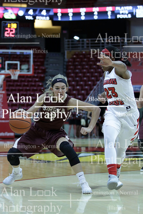 01 November 2017: Hayley Reneau comes across the 3 point line guarded by Viria Livingston during a Exhibition College Women's Basketball game between Illinois State University Redbirds the Red Devils of Eureka College at Redbird Arena in Normal Illinois.