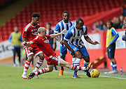 Willo Flood tackles Chris O'Grady during the Pre-Season Friendly match between Aberdeen and Brighton and Hove Albion at Pittodrie Stadium, Aberdeen, Scotland on 26 July 2015.