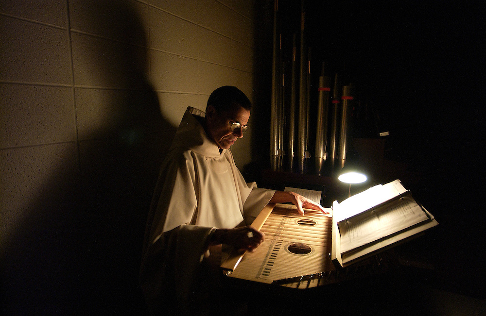 A Trappist Monk plays the zither at the Assumption Abby in Missouri.