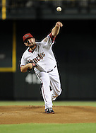 Jul. 26, 2012; Phoenix, AZ, USA; Arizona Diamondbacks pitcher Wade Miley (36) pitches during the game against the New York Mets in the first inning at Chase Field.  Mandatory Credit: Jennifer Stewart-US PRESSWIRE.