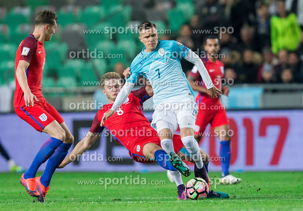 Josip Ilicic of Slovenia faulted by Eric Dier of England during football match between National teams of Slovenia and England in Round #3 of FIFA World Cup Russia 2018 Qualifier Group F, on October 11, 2016 in SRC Stozice, Ljubljana, Slovenia. Photo by Vid Ponikvar / Sportida