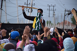 May 5, 2018 - Srinagar, Jammu & Kashmir, India - People shouting anti indian slogans during multiple funerals held in Indian Kashmir. .Multiple Funeral processions held in srinagar summer capital of Indian Kashmir on Saturday of Fayaz Ahmed Hamal a LeT (Lashkar-e-Taiba) Militant and a Civilian Adil Ahmed Yatoo who were killed by armoured vehicle on Saturday during clashes near Encounter site..Thousands of peoples including men, women, childrens attended the funeral procession of civilian and Militant at their residence. .4 Killed and several injured in an encounter between Indian forces and militants at chatabal area of Srinagar summer capital of Indian Kashmir on Saturday. Three militants were killed during a brief shootout after government forces laid seige around densely populated chatabal area of Srinagar. A young man also died after he was hit by the armoured vehicle during the clashes between the residents and police force as residents tried to help the Militants in escape. (Credit Image: © Abbas Idrees/SOPA Images via ZUMA Wire)