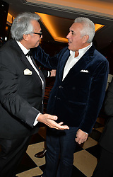 Left to right, SIR DAVID TANG and LAWRENCE STROLL at the London launch of Casamigos Tequila hosted by Rande Gerber, George Clooney & Michael Meldman and to celebrate Cindy Crawford's new book 'Becoming' held at The Beaumont Hotel, Brown Hart Gardens, 8 Balderton Street, London on 1st October 2015.