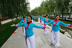 epa06264981 Chinese residents of the Jixiang Dance Group perform during a reporting trip organised by the government for journalists ahead of the 19th National Congress in Beijing, China, 14 October 2017. The Communist Party of China (CPC) is making preparations for the five-yearly 19th National Congress scheduled to begin next week on 18 October. During the Congress members will elect a new Central Committee, including a new 24-member Politburo and a new seven-member Standing Committee.  EPA-EFE/HOW HWEE YOUNG