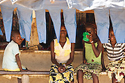 Children sit at the counter of a local cafe in the village of Popoko, Bas-Sassandra region, Cote d'Ivoire on Tuesday March 6, 2012.