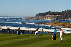 Feb 8, 2012; Pebble Beach CA, USA;  Rickie Fowler (right) hits a shot on the fourth hole during the celebrity challenge of the AT&T Pebble Beach Pro-Am at Pebble Beach Golf Links. Mandatory Credit: Jason O. Watson-US PRESSWIRE
