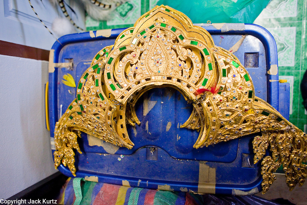 "Oct. 7, 2009 -- BANGKOK, THAILAND:  A traditional style Thai headdress worn in the revue by ""ladyboys"" backstage at the Mambo Cabaret in Bangkok, Thailand. The performers at the Mambo Cabaret in Bangkok, Thailand are all ""Ladyboys,"" or kathoeys in Thai. Recognized as a third gender, between male and female, they are born biologically male but live their lives as women. Many kathoey realize they are third gender in their early teens, some only as old 12 or 13. Kathoeys frequently undergo gender reassignment surgery to become women. Being a kathoey in Thailand does not carry the same negative connotation that being a transgendered person in the West does. A number of prominent Thai entertainers are kathoeys. Photo by Jack Kurtz / ZUMA Press"