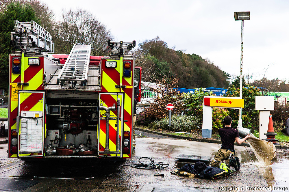 Jedburgh, Scottish Borders, UK. 27th January 2016. Fire crews clear up Jedburgh after the town flooded and blocked its main artery the A68 road. The area recieved intense torrential rainfall on Wednesday morning.