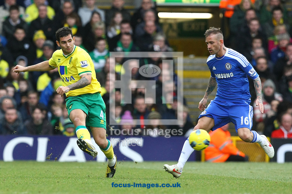 Picture by Paul Chesterton/Focus Images Ltd.  07904 640267.21/01/12.Bradley Johnson of Norwich and Raul Meireles of Chelsea in action during the Barclays Premier League match at Carrow Road Stadium, Norwich.