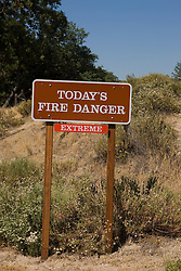 A National Park Service warning sign indicating that the fire danger for Pinnacles National Monument is extreme, California, USA.