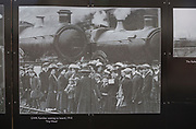 public display of old historic images about the GWR works, Swindon, Wiltshire, England, UK families waiting to board train for trip week 1910