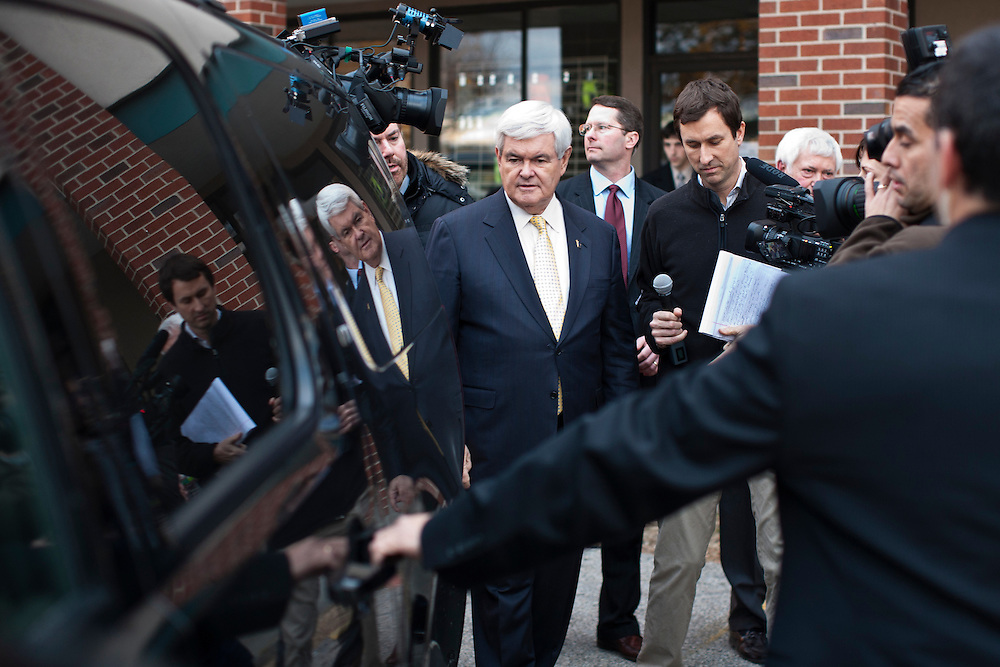 Republican presidential candidate Newt Gingrich walks to his SUV after a town hall meeting at Don Quijote restaurant on Sunday, January 8, 2012 in Manchester, NH. Brendan Hoffman for the New York Times
