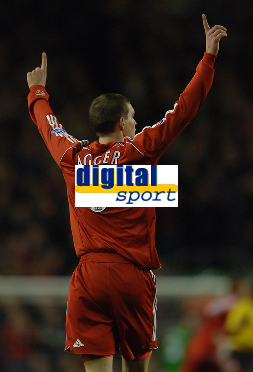 Photo: Paul Greenwood.<br />Liverpool v Arsenal. The FA Cup. 06/01/2007. Liverpools Daniel Agger celebrates as Dirk Kuyt pulls one back