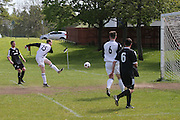 James Cochrane scores for Sidlaw Thistle - Cannon Fodder (black) v Sidlaw Thistle (white) - Dundee Saturday Morning Football League at Drumgieth<br /> <br />  - &copy; David Young - www.davidyoungphoto.co.uk - email: davidyoungphoto@gmail.com