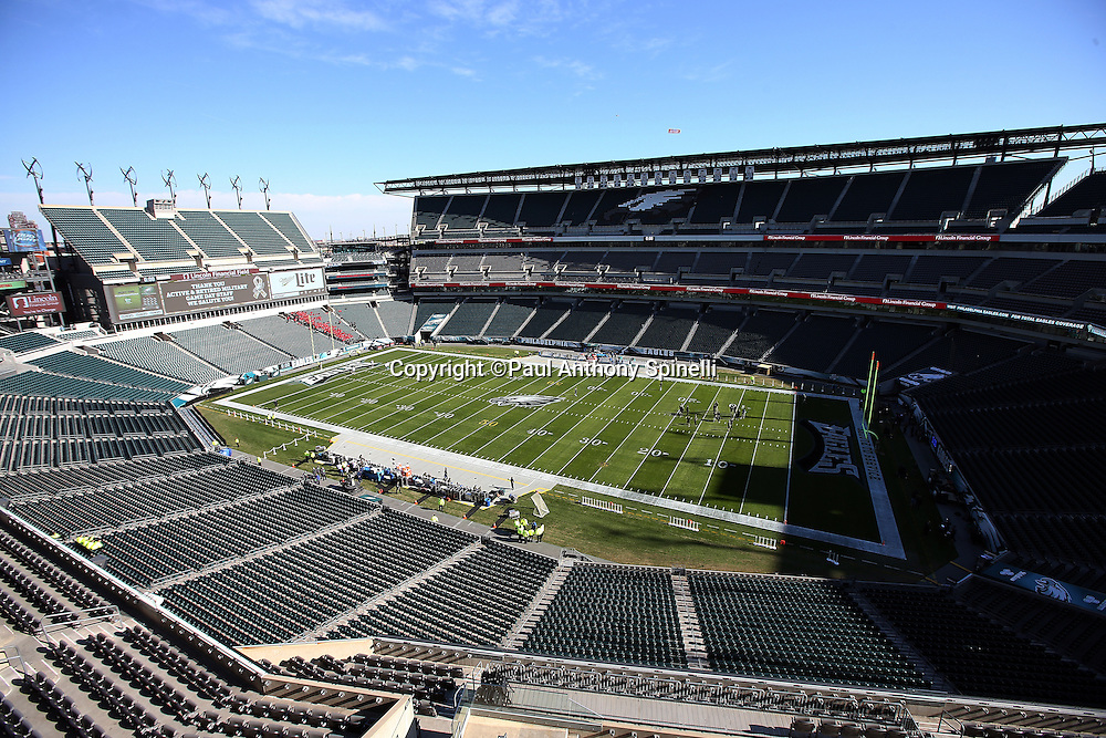 Philadelphia Eagles players begin warming up in this general view, overhead, wide angle photograph of Lincoln Financial Field taken before the 2015 week 10 regular season NFL football game against the Miami Dolphins on Sunday, Nov. 15, 2015 in Philadelphia. (©Paul Anthony Spinelli)
