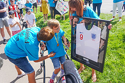 © Licensed to London News Pictures. 01/08/2020. Sheffield, UK. Tobias Weller aged 9,Sheffield, receives his English jersey after he completes the final 1.2km leg of his marathon in Sheffield, South Yorkshire. Nine-year-old Tobias Weller, from Sheffield, who has cerebral palsy and autism, has raised over £100,000 for Children Hospital Charity and Paces by walking a 26.2-mile marathon during the lockdown. Tobias Weller has been inspired by WWII veteran Captain Sir Thomas Moore to take his fundraising one step ahead.<br />  Photo credit: Ioannis Alexopoulos/LNP