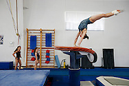 Younger gymnasts look on as Rachel Gowey, 18, of Urbandale practices her vault Saturday, June 18, 2016, at Chow's Gymnastics and Dance in West Des Moines. Gowey started working out at the gym around age five and has progressed into one of the top female gymnasts in the country.