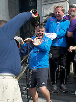 "03/06/2014 After walking 108 miles from Donegal to Galway, Ronnie Whelan's ""Myaware.ie Annual Walk"" in aid of Myasthenia, arrived to Hotel Meyrick in Galway city centre was Ronnie Whelan and  Love/Hate's Elmo Laurence Kinlan who got a bubbly surprise from Paul Brennan . Photo:Andrew Downes"