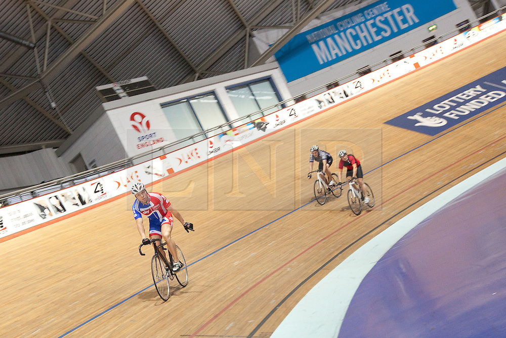 © Licensed to London News Pictures. 25/09/2012. Manchester, UK. Sir Chris Hoy races with competition winners from across the UK at the National Cycling Centre , Manchester . Sky Ride competition entrants won the opportunity to cycle with the Olympic Gold Medallist . Photo credit : Joel Goodman/LNP