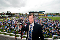 Bristol Rovers Manager, Darrell Clarke poses for a photo with the Vanarama Conference Play-Off Final trophy during the Bristol Rovers celebration bus tour - Photo mandatory by-line: Dougie Allward/JMP - Mobile: 07966 386802 - 25/05/2015 - SPORT - Football - Bristol - Bristol Rovers Bus Tour