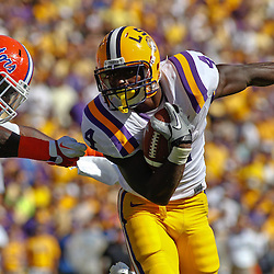 October 8, 2011; Baton Rouge, LA, USA;  LSU Tigers running back Alfred Blue (4) runs past Florida Gators defensive end Ronald Powell (7) during the first quarter at Tiger Stadium.  Mandatory Credit: Derick E. Hingle-US PRESSWIRE / © Derick E. Hingle 2011