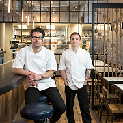 April 11, 2015 - New York, NY : Owner George Mendes, left, and chef Brad Willits pose for a portrait in the dining room of their soon-to-open Portuguese restaurant Lupulo, at 835 6th Ave. in Manhattan, on Saturday afternoon.  CREDIT: Karsten Moran for The New York Times