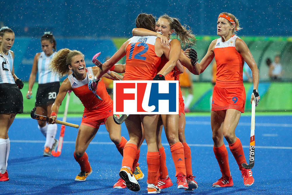 RIO DE JANEIRO, BRAZIL - AUGUST 15:  Maria Verschoor #11, Lidewij Welten #12, Kelly Jonker #10 and Carlien Dirkse van den Heuvel #9 of Netherlands celebrate after Welten scored a first half goal against Argentina during the quarter final hockey game on Day 10 of the Rio 2016 Olympic Games at the Olympic Hockey Centre on August 15, 2016 in Rio de Janeiro, Brazil.  (Photo by Christian Petersen/Getty Images)