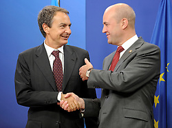 Jose Zapatero, Spain's prime minister, left, is greeted by Fredrik Reinfeldt, Sweden's prime minister and standing president of the European Council, as he arrives for the European Summit at the EU headquarters in Brussels, Belgium, on Thursday, Sept. 17, 2009. European Union leaders may call for sanctions on banks that pay excessive bonuses, fearing that runaway executive pay could trigger another financial crisis, a draft text showed. (Photo © Jock Fistick)