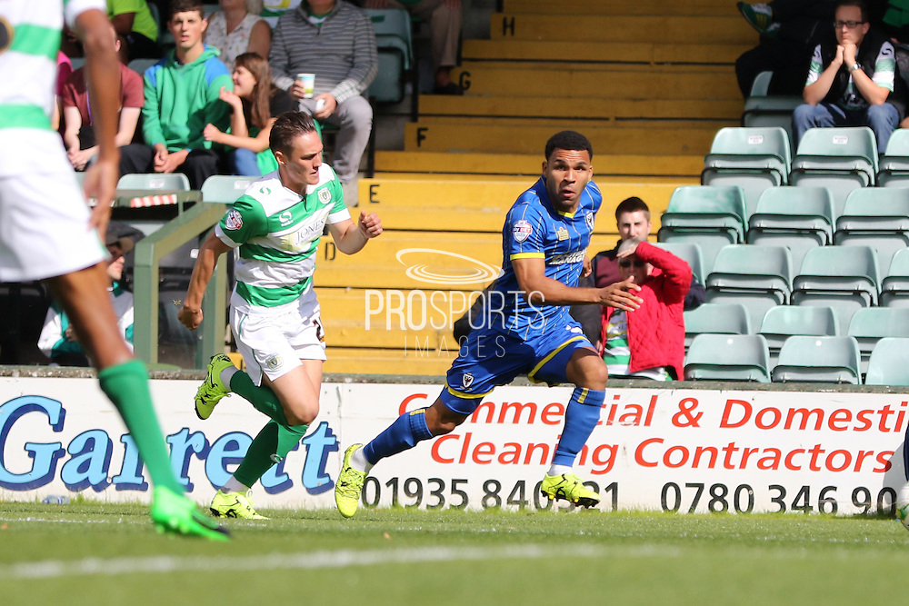 Andy Barcham of AFC Wimbledon races on during the Sky Bet League 2 match between Yeovil Town and AFC Wimbledon at Huish Park, Yeovil, England on 12 September 2015. Photo by Stuart Butcher.