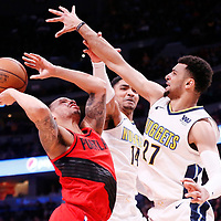 09 April 2018: Denver Nuggets guard Gary Harris (14) and Denver Nuggets guard Jamal Murray (27) defends on Portland Trail Blazers guard Shabazz Napier (6) during the Denver Nuggets 88-82 victory over the Portland Trail Blazers, at the Pepsi Center, Denver, Colorado, USA.