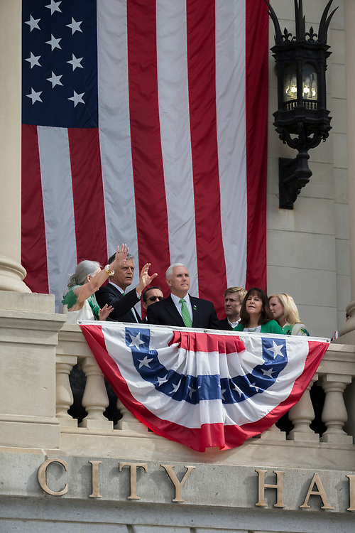 Vice President Mike Pence, center and his wife Karen Pence, right, join Savannah Mayor Eddie DeLoach, center right, and his wife Cynthia DeLoach, left, watch the St. Patrick's Day parade from the balcony at City Hall, Saturday, March 17, 2018, in Savannah, Ga. (AP Photo/Stephen B. Morton)